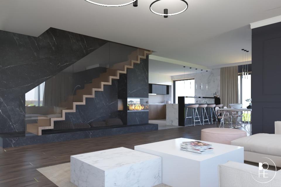 Projekt wnętrza salonu domu w Białymstoku z widokiem na drewniane schody dywanowe ze szklaną balustradą