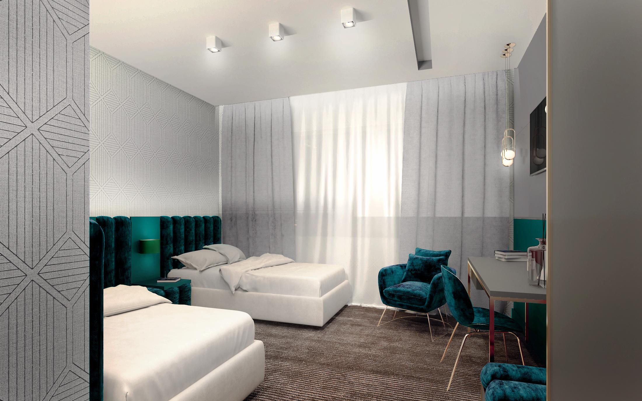 Pokój hotelowy w kolorze szmaragdowym ze złotymi elementami z dwoma łóżkami projektu BOHE Architektura