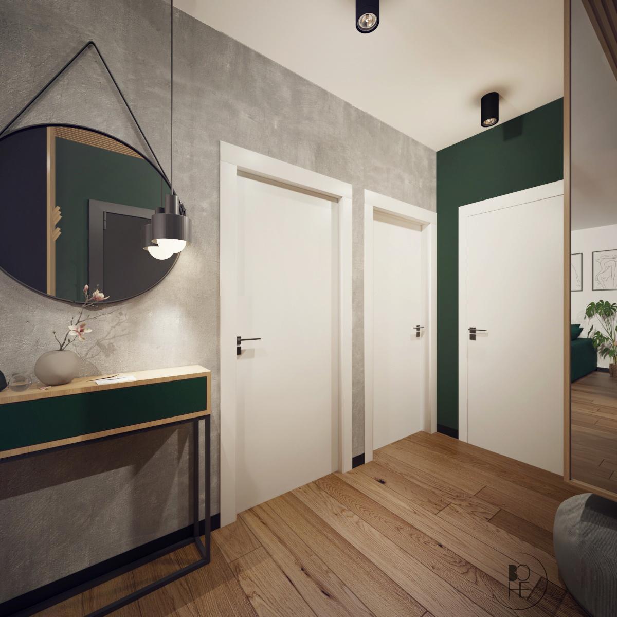 projekty wnętrz Łódź aranżacja korytarza w zielono szarych barwach z okrągłym lustrem